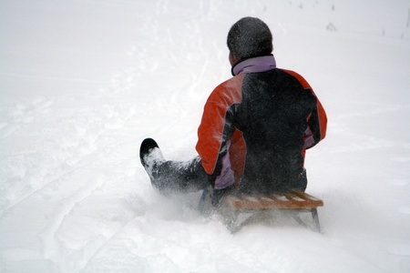 sledding: young people have fun in the winter Stock Photo