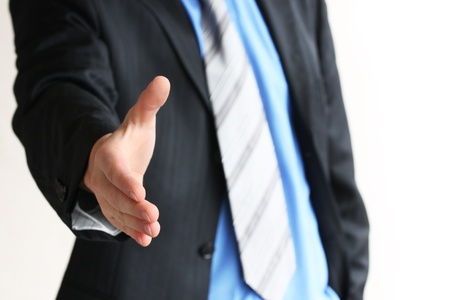 Young business man giving hand for handshake photo