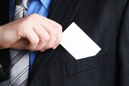 show cards: Businessman holding his business card in hand