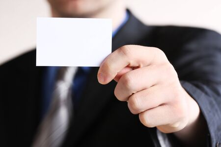 visiting card: Businessman holding his business card in hand