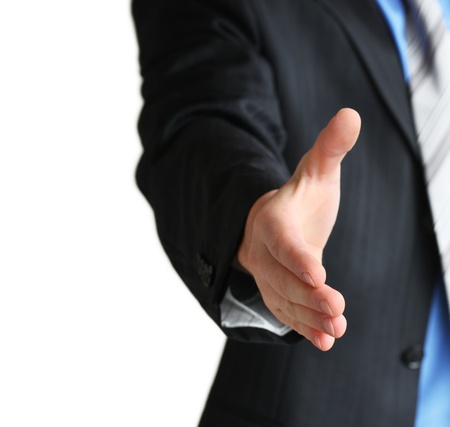 Young business man giving hand for handshake Stock Photo