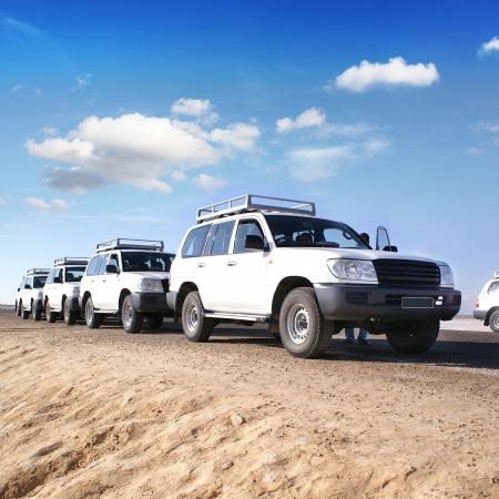 travel by jeep over by desert africa Standard-Bild