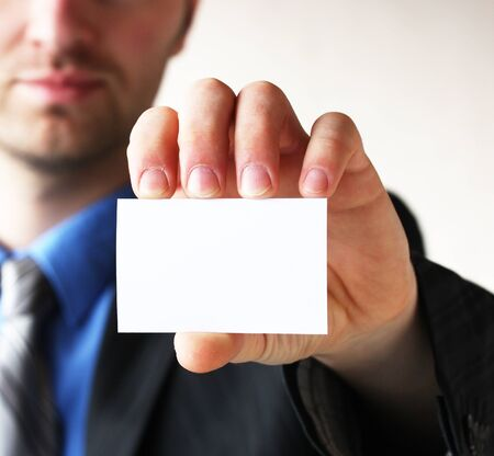 Businessman holding his business card in hand Stock Photo - 14000692