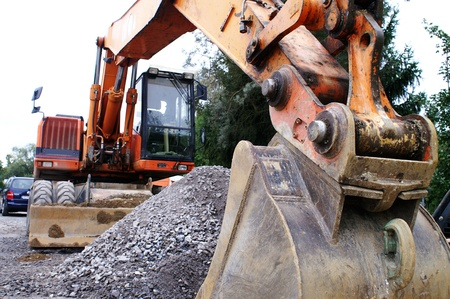 heavy equipment operator: large excavator at the construction site in germany