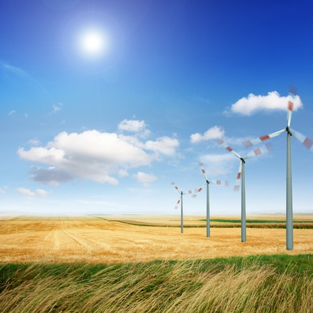 windfarm: Wind turbine generate electricity on a sunny day Stock Photo