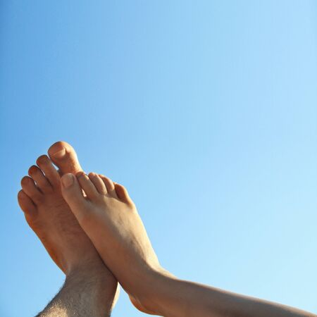 human toe: male and female foot high direction sky