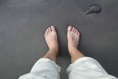 barefoot man on sea beach photo