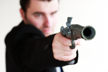man holding gun: Businessman takes to gun to protect his business Stock Photo