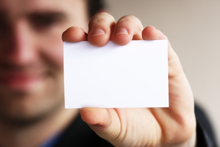 visiting card design: Businessman holding his business card in hand