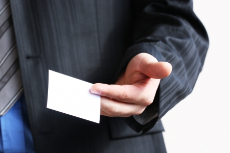 Businessman holding his business card in hand Stock Photo - 14273121