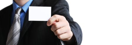 Businessman holding his business card in hand Stock Photo - 14273105