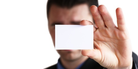 Businessman holding his business card in hand photo