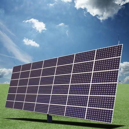 Solar panels generate electricity on a sunny day photo