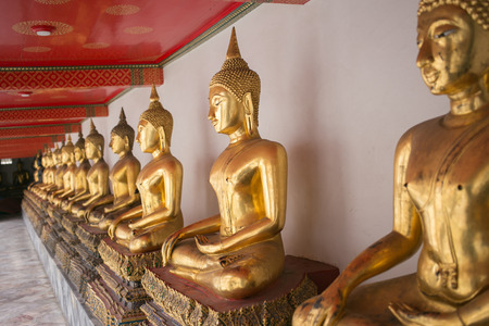 squat: Buddha statue squat posture at Wat Arun, Bangkok Thailand.