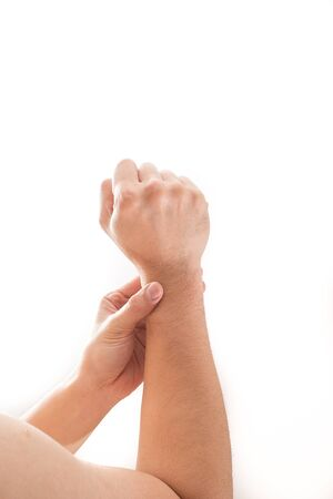 enhanced health: Man wrist pain concept, Male holding hand to spot of wrist pain.