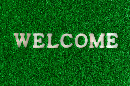 synthetic fiber: Welcome word plastic with rubber capet colorful in red green blue.