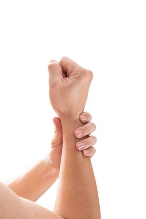 Man wrist pain concept, Male holding hand to spot of wrist pain.