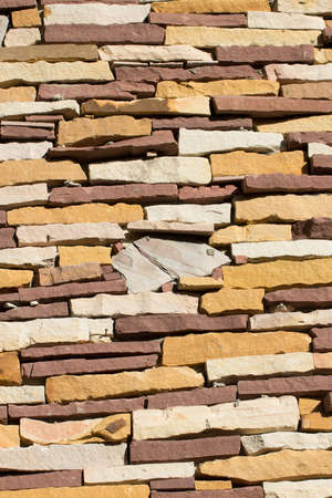 yellow stone: Yellow stone wall brick texture and background for design.