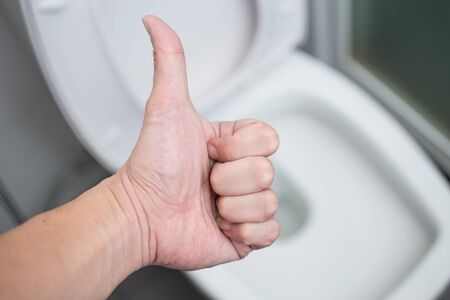 Great: Hand show sign Good Thumb Up with background cleaning Toilets Bathroom Toilet Seats or Bidets.