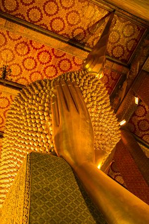 Head of Hue Golden Buddha reclining(Phra Saiyat) in Wat Pho Bangkok - THAILAND.