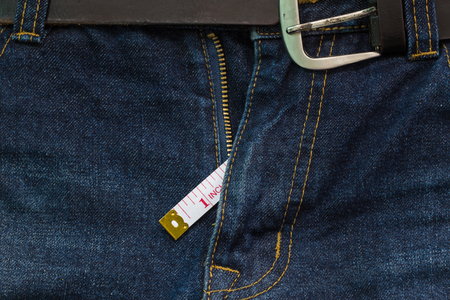 jeans open zip with measuring tape, small penis size concept Stock Photo