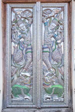 angles: Beautiful Carved Angles Silver Door Lanna Architecture Chiangmai, THAILAND.