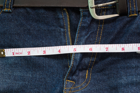 crotch: jeans open zip with measuring tape, penis size concept Stock Photo
