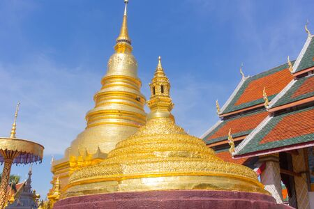 hariphunchai: Thai Golden pagoda and Chapel Roof Wat Phrathat Hariphunchai Woramaha vihan, Lamphun, THAILAND. Stock Photo