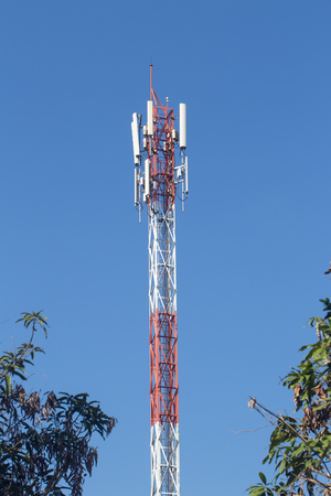 hight tech: Cell site, Telecommunications radio tower or mobile phone base station with atop the antenna. Stock Photo