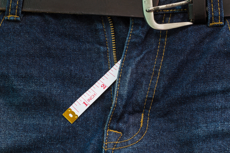 jeans open zip with measuring tape, penis size concept Stockfoto