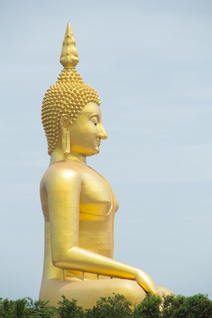 large Gold buddha statue under construction in Thai temple with clear sky Stock Photo