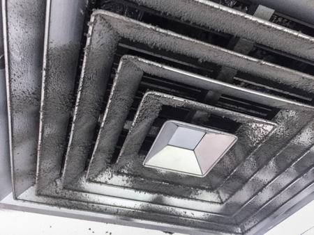 Dust out from Air Duct, Danger and the cause of pneumonia in office man. 写真素材