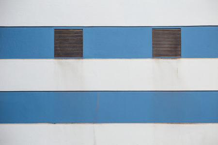 air duct: air duct on blue and white pattern concrete wall background with space for text Stock Photo