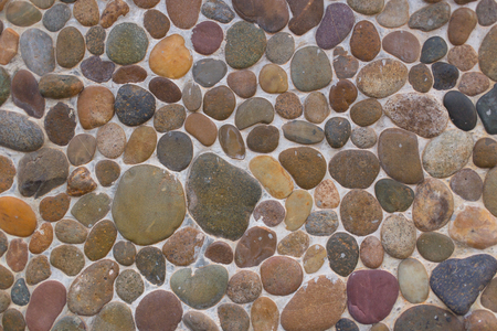 River Stone Or Rocks Wall Background Or Texture For Design Stock