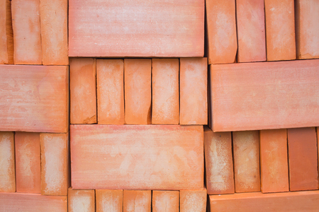 pitting: Red brick for construction background or texture. Stock Photo