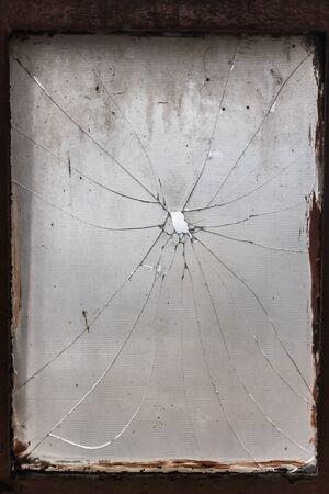 broken glass window: bullet broken glass window Stock Photo
