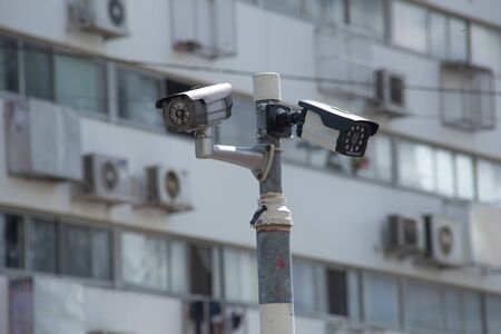video surveillance: CCTV Camera or surveillance on apartment or condominiumin background Stock Photo