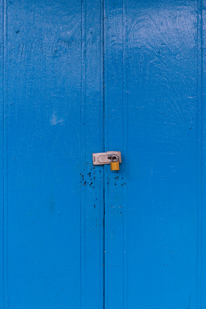 locked: blue locked wood door