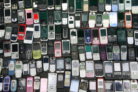 Bangkok, Thailand - May 05, 2012: Second hand Vintage Feature Mobile Phone sale for spare part in Klong Thom market in Bangkok Thailand. Editorial