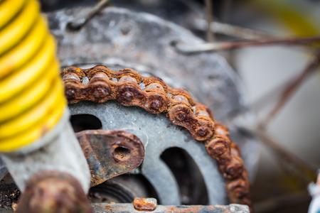rusty chain: rusty motorcycle chain.