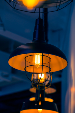 hung: Retro style hung bulb lamp, loft style interior decoration with space for text.
