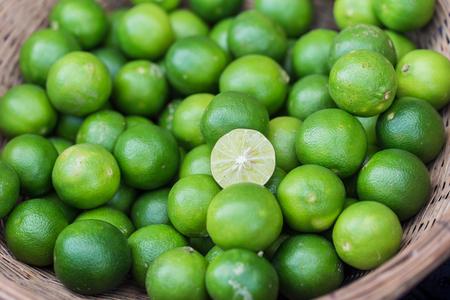 Lime, Asian lemon or mini lemon green fruit sour for food ingredient. Stock Photo