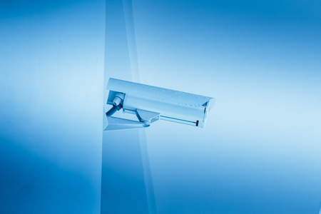 campus building: CCTV camera in the school or university campus building, white clean trust security concept blue color tone.