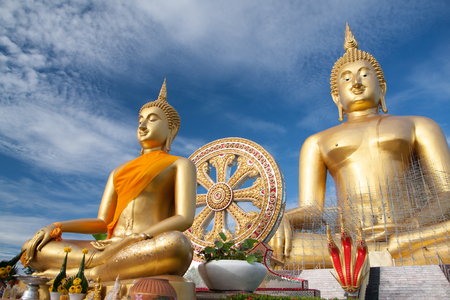 clouds making: Gold buddha statue under construction in Thai temple with clear sky.WAT MUANG, Ang Thong, THAILAND. Stock Photo
