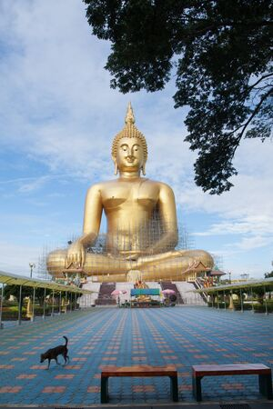 Gold buddha in Thai temple with clear sky.WAT MUANG, Ang Thong, THAILAND.