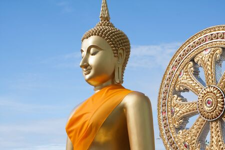 Closeup Gold buddha in Thai temple with clear sky.WAT MUANG, Ang Thong, THAILAND.