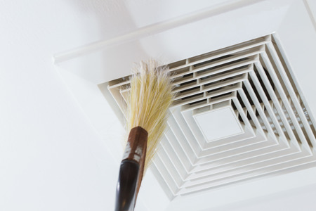 Cleaning Air Duct with Brush, Danger and the cause of pneumonia in office man.