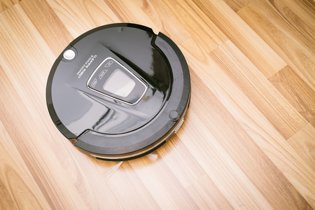 New Clean Robot Vacuum Cleaner On Laminate Wood Floor Smart Stock