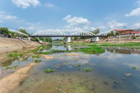 wang: White Bridge across Wang river, Ratsadaphisek Bridge most popular tourist travel sightseeing in Nakhon Lampang, Thailand.