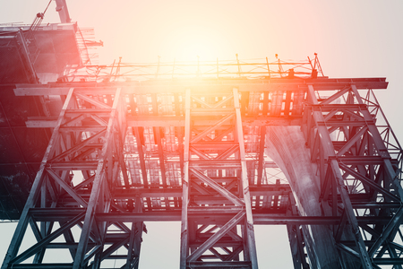 High Steel structure reach the sun, Rise of Sky Train Rail (BTS) Construction Building in Bangkok City Metropolis.
